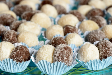 Several black and white chocolate truffles ready to be served