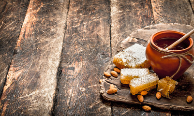 Wall Mural - Fresh honey with almonds.