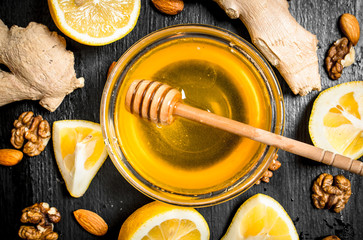 Wall Mural - Honey background.Fresh honey with ginger and lemon.