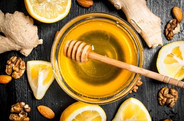 Wall Mural - Honey background.Fresh honey with ginger and lemon.