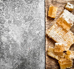 Wall Mural - Honey background. Fresh honeycomb on the Board.
