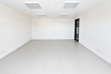Interior empty office light room with white wallpaper unfurnished in a new building