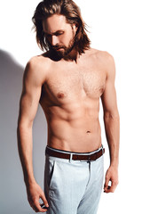 portrait of handsome fashion stylish hipster model man with bare chest isolated on white