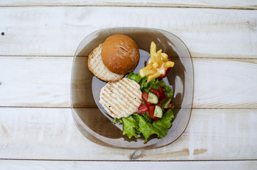 Tasty burger with lettuce and French fries. Snack. Fast food.