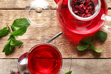 Composition with hibiscus tea on wooden table. Weight loss concept
