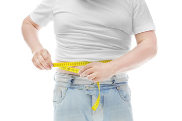 Overweight man measuring his waist on white background. Diet concept