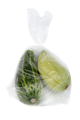 Courgettes in plastic bag isolated on white.