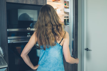 Woman opening refrigerator