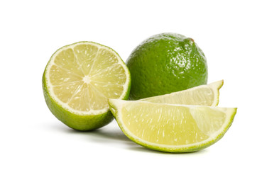 lime and  slices of limes  isolated on white background