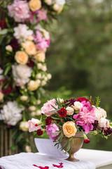 flowers in vases on wedding ceremony
