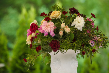 flowers in vases on wedding ceremony