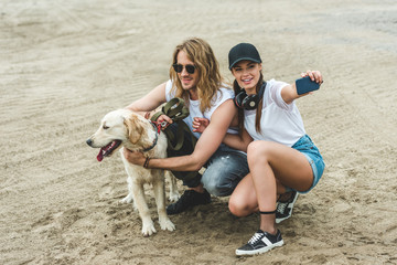 couple with dog taking selfie