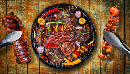 Poster Grill / Barbecue Top view of fresh meat and vegetable on grill placed on wooden planks