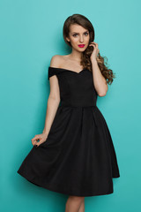 Beautiful Young Woman In Elegant Black Cocktail Dress