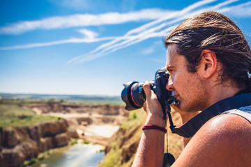 Landscape traveller photographer with camera taking shot of quarry