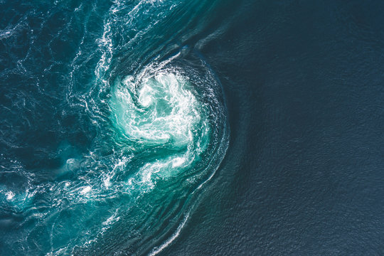 Whirlpools of the maelstrom of Saltstraumen, Nordland, Norway . Saltstraumen is a small strait with one of the strongest tidal currents in the world. B y Letowa.