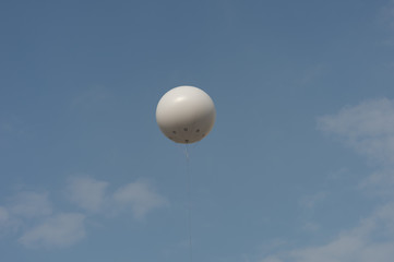 White balloons in the sky.