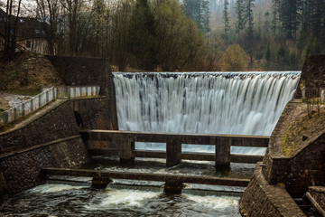 Stone dam and waterfall in Wisla city in Beskid mountains, Silesia, Poland