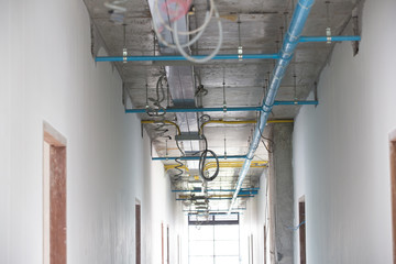 Water and electricity piping systems in buildings