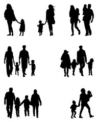 Black silhouettes of families at walking on a white background