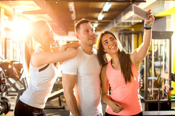 Athletic friends taking a selfie at the gym.