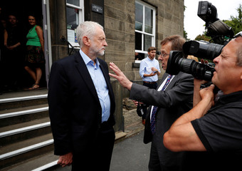 Britain's opposition Labour party leader, Jeremy Corbyn, is interviewed during a visit to a museum in Rawtenstall