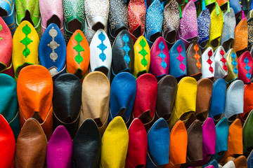 assorted shoes at market stall in morocco