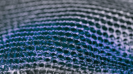 Blue abstract texture from mesh. Artistic detail of hexagonal grid in HD 16x9 ratio. Concept for science, research, technology and industry.