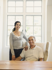 Portrait of couple posing near window