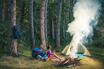 Camping couple. Passionate couple kissing, boy and girl. Having sex. Young lovers. People in love. Positions kamasutra. Erotic moments. Concept photo. Secret. Fashion. Hot babe. Party. People, fire.
