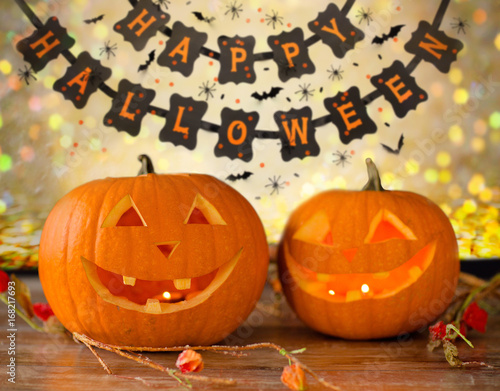 carved pumpkins and happy halloween garland