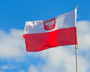 Polish flag with emblem of white eagle.