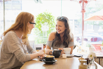 Friends laughing in coffee shop