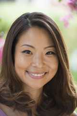 Portrait of Asian woman smiling outdoors