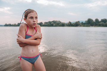 Girl shivering after a swim in the river
