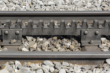 Close-up of a railroad track with a rack