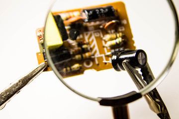 Repair computer boards under a magnifying glass