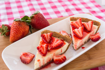 Photo of Two Slices Cheesecake With Fresh Strawberries