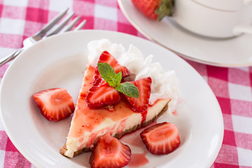Piece of Cheesecake With Fresh Sliced Strawberries With Fork