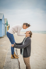 Caucasian couple embracing on beach