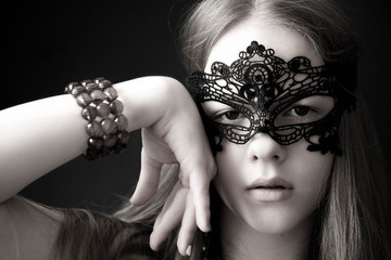 The girl in a mask with a hand at the person