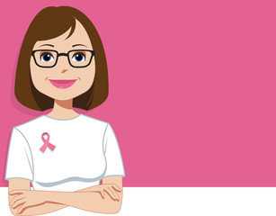 Young woman wearing pink ribbon, the symbol of breast cancer awareness