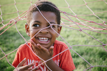 Young boy playing in goalpost