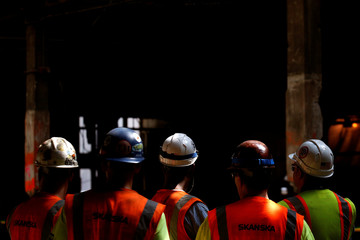 Construction workers attend an announcement by New York Governor Andrew Cuomo at The Moynihan Train Hall in New York