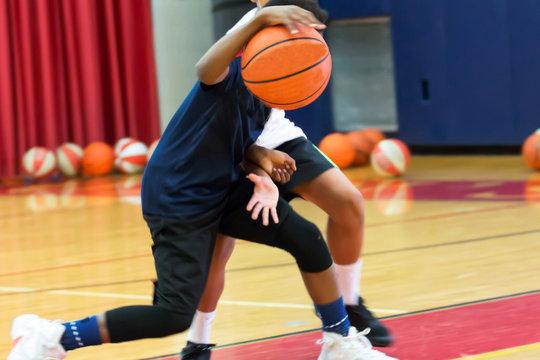 Dribbling a basketball at summer camp
