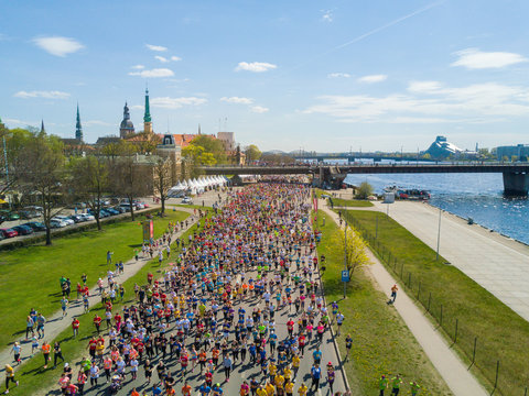 Aerial view of people running in the Riga Lattelecom marathon 2017 from the old town down to the center.