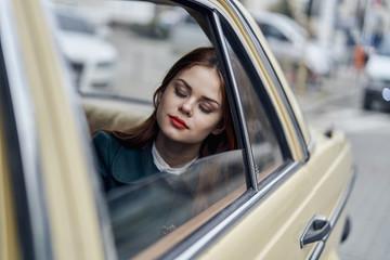 Caucasian woman sleeping in back seat of car