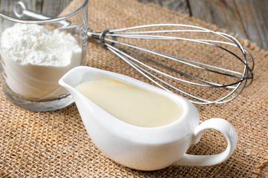 Bechamel white sauce in gravy boat