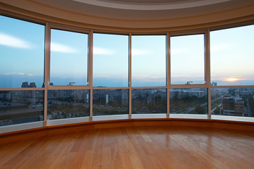 Oval glass wall with city view