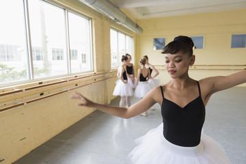 Girl practicing in ballet studio
